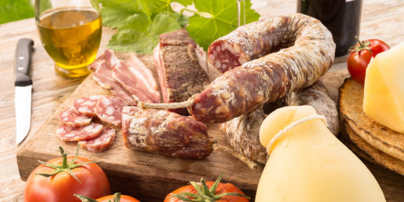Cold cuts and cheeses. shutterstock.com by Alessio Orru.